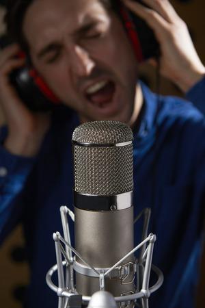 vocalist: Male Vocalist In Recording Studio Stock Photo