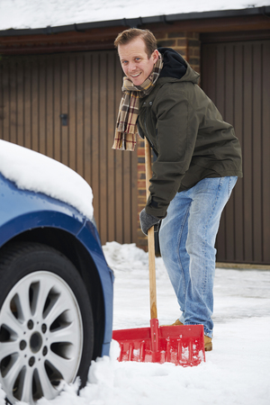 motorist: Motorist Digging Car Out Of Snow