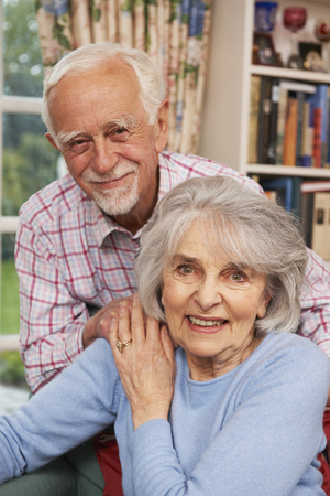 the ageing process: Affectionate Senior Couple At Home Together