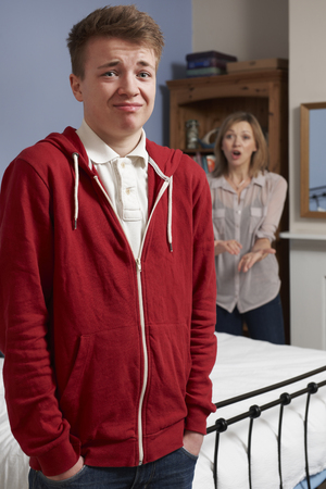 told: Teenage Boy Being Told Off By Mother Stock Photo