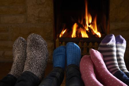 fire wood heat: Family Warming Feet By Fire