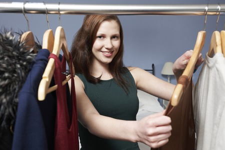 choosing clothes: Teenage Girl Choosing Clothes From Wardrobe