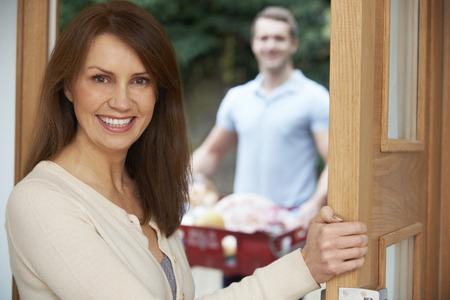 shopping order: Driver Delivering Online Grocery Shopping Order