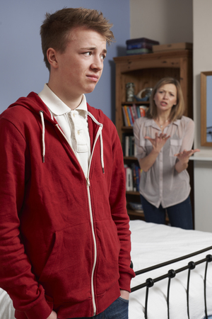 Teenage Boy Being Told Off By Mother Foto de archivo