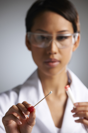 swab: Female Scientist Collecting DNA Sample On Swab Stock Photo