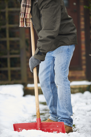 clearing the path: Close Up Of Man Clearing Snow From Path
