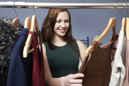 teenage girl: Teenage Girl Choosing Outfit From Wardrobe Stock Photo