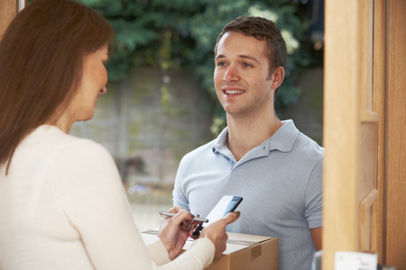 service man: Courier Delivering Package To Domestic House