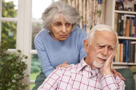 comforting: Woman Comforting Senior Man With Depression Stock Photo