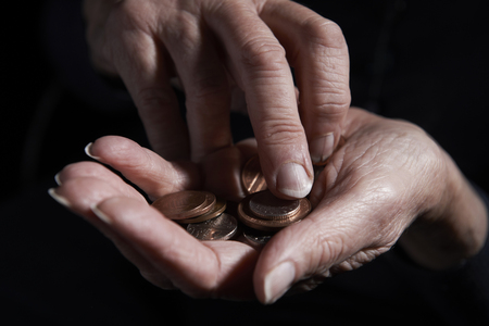 unrecognisable person: Senior Woman Counting Coins In Hand