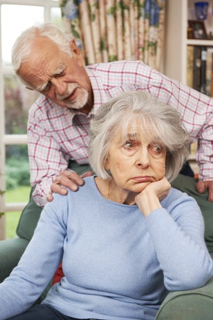 70s adult: Man Comforting Senior Woman With Depression