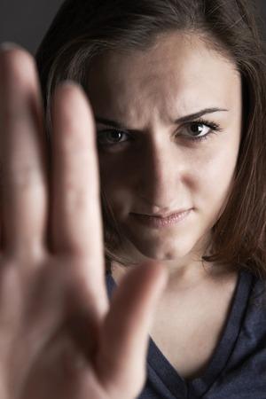 non verbal: Frightened Teenage Girl Making Stop Gesture