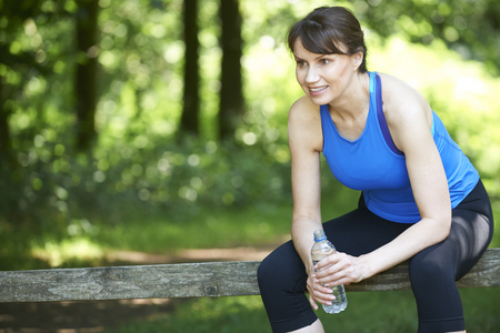 middle aged women: Middle Aged Woman Resting After Exercise