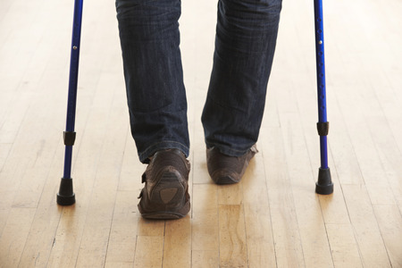 crutches: Close Up Of Man Using Crutches