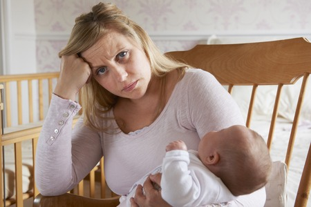 mommy: Tired Mother Suffering With Post Natal Depression Stock Photo