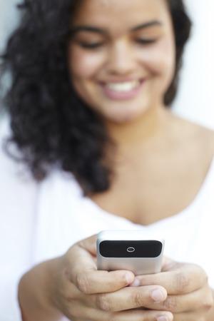 sending: Young Woman Sending Text Message