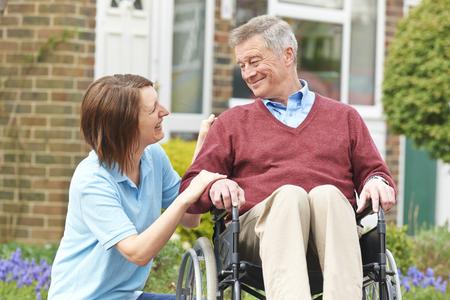 wheelchair man: Carer With Senior Man In Wheelchair