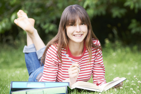 learing: Young Female Student Studying In Park Stock Photo