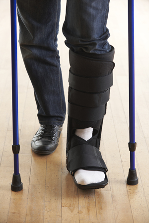 leg injury: Close Up Of Man Walking With Crutches And Cast Stock Photo