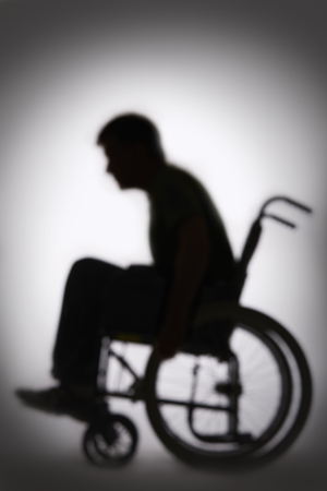 physical impairment: Silhouette Of Disabled Person In Wheelchair