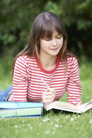 learing: Student Studying Outdoors In Park