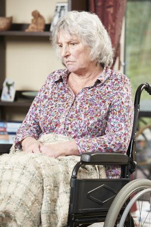 Unhappy Senior Woman Sitting In Wheelchair