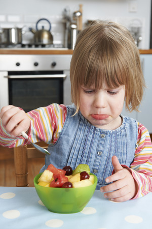 rejecting: Fussy Child Rejecting Delicious Fruit Salad Pudding