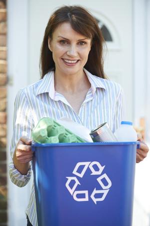 recycling bin: Middle Aged Woman Carrying Recycling Bin
