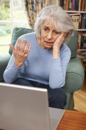 silver surfer: Frustrated Senior Woman Using Laptop
