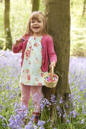 bluebell woods: Girl On Easter Egg Hunt In Bluebell Woods Stock Photo