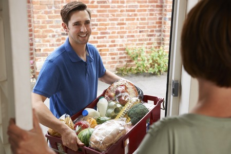 man and women: Driver Delivering Online Grocery Shopping Order