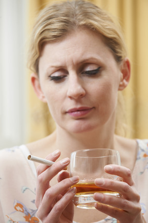 sobriety: Woman Holding Glass Of Whisky And Cigarette
