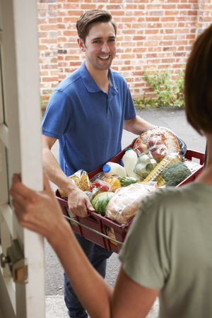 grocery shopping: Driver Delivering Online Grocery Shopping Order