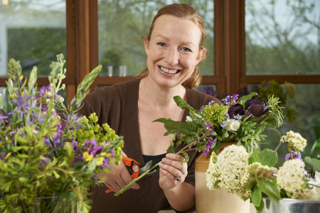 florist shop: Florist Working On Arrangement In Flower Shop Stock Photo