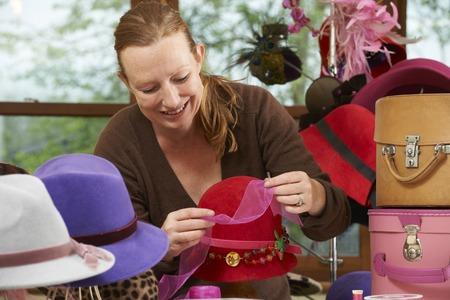 Hat Maker Working On Design In Studio Banco de Imagens