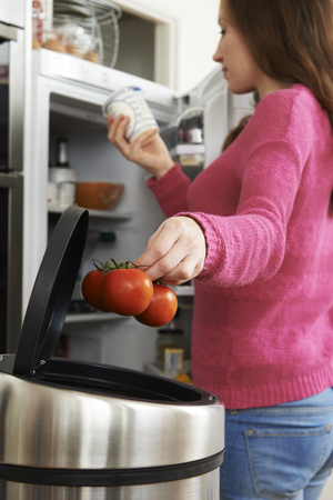 out of date: Woman Throwing Away Out Of Date Food In Refrigerator