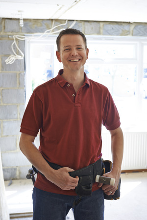 rennovation: Portrait Of Builder Carrying Out Home Improvements Stock Photo