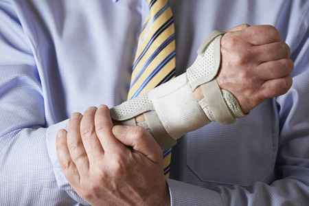 carpal tunnel syndrome: Close Up Of Businessman Suffering With Repetitive Strain Injury (RSI)