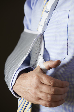 sick leave: Close Up Of Businessman With Arm In Sling Stock Photo