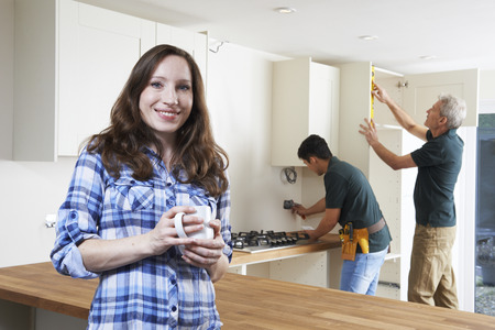 happy customer: Portrait Of Woman Having New Kitchen Fitted
