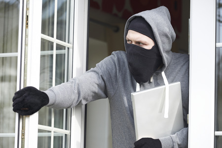 antisocial: Burglar Breaking Into House And Stealing Laptop Computer