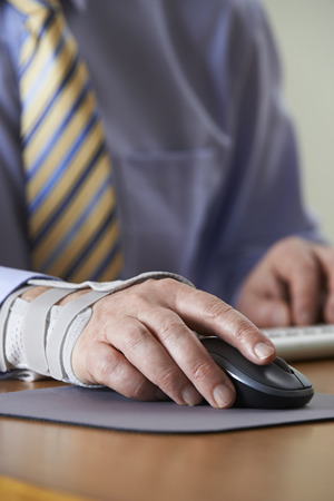 strain: Businessman Suffering From Repetitive Strain Injury (RSI) Stock Photo