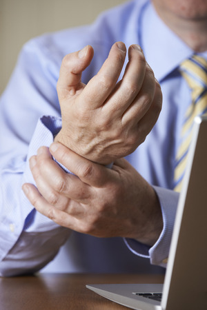carpal tunnel syndrome: Businessman Suffering From Repetitive Strain Injury (RSI) Stock Photo