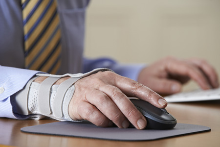 wrist pain: Businessman Suffering From Repetitive Strain Injury (RSI) Stock Photo
