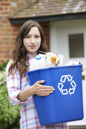 domestic life: Portrait Of Woman Carrying Recycling Bin