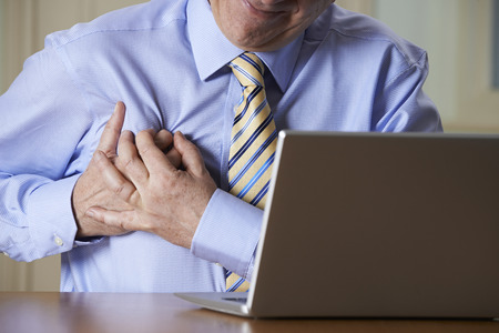 hands heart: Businessman At Computer Suffering Heart Attack