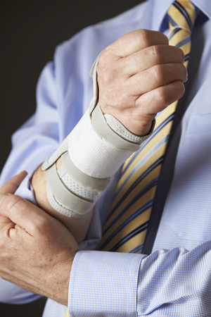 sick leave: Close Up Of Businessman Suffering With Repetitive Strain Injury (RSI)