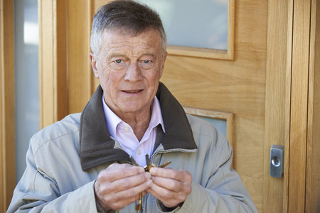forgetful: Confused Senior Man Trying To Find Door Key