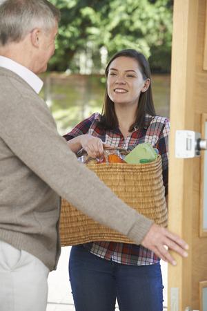neighbour: Teenage Girl Doing Shopping For Elderly Neighbour Stock Photo