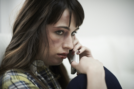 domestic violence: Female Victim Of Domestic Abuse Phoning Support Group